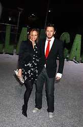 STELLA MCCARTNEY and husband ALASDHAIR WILLIS at a party to celebrate the Stella McCartney's unique collaboration with fashion store H&M at St.Olavs, Tooley Street, London SE1 on 25th October 2005.<br /><br />NON EXCLUSIVE - WORLD RIGHTS