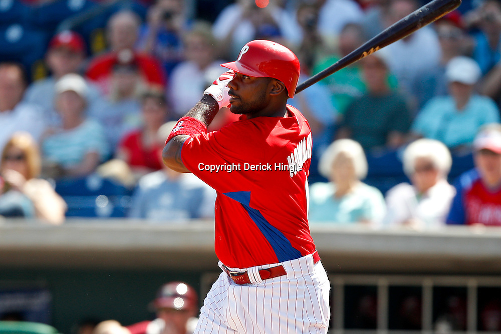 February 24, 2011; Clearwater, FL, USA; Philadelphia Phillies first baseman Ryan Howard (6) connects on a two run double in the first inning of a spring training exhibition game against the Florida State Seminoles at Bright House Networks Field. The Phillies defeated the Seminoles 8-0. Mandatory Credit: Derick E. Hingle
