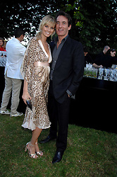 TIM JEFFERIES and his fiance MALIN JOHNANSSON at the annual Serpentine Gallery Summer Party in association with Swarovski held at the gallery, Kensington Gardens, London on 11th July 2007.<br />