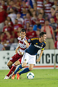 FRISCO, TX - AUGUST 11:  Robbie Keane #7 of the Los Angeles Galaxy controls the ball while defended by Matt Hedges #24 of FC Dallas on August 11, 2013 at FC Dallas Stadium in Frisco, Texas.  (Photo by Cooper Neill/Getty Images) *** Local Caption *** Robbie Keane; Matt Hedges