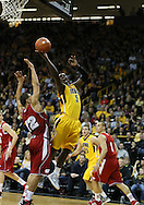 January 19 2013: Iowa Hawkeyes guard Anthony Clemmons (5) puts up a shot over Wisconsin Badgers guard Traevon Jackson (12) during the first half of the NCAA basketball game between the Wisconsin Badgers and the Iowa Hawkeyes at Carver-Hawkeye Arena in Iowa City, Iowa on Sautrday January 19 2013. Iowa defeated Wisconsin 70-66.