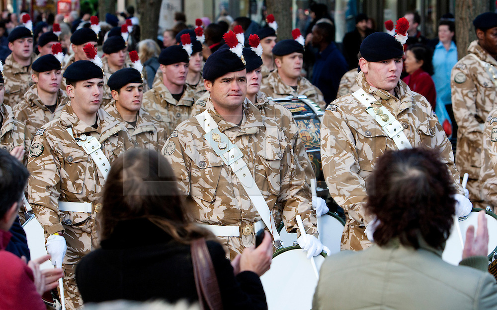 © London News Pictures. Private LEE RIGBY (far left), a drummer in the the Royal Regiment of Fusiliers, taking part in a march through Hounslow, London on 26 November 2009, when the regiment was granted the Freedom of the Borough after returning from a tour of duty in Afghanistan. Michael Adebowale and Michael Adebolajo are standing  trial at The Old Bailey in Central London accused of murdering Drummer Lee Rigby. Photo credit: London News Pictures