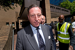 © London News Pictures. 05/06/2013. London, UK. NEVILLE THURLBECK, Former news editor at the News of The World, leaving Southwark Crown Court in London where he faced charges relating to phone hacking scandal at the News of The World. Photo credit: Ben Cawthra/LNP  Three former News of the World staff have pleaded guilty to charges related to hacking phones, the trial of Rebekah Brooks and Andy Coulson heard.<br />
