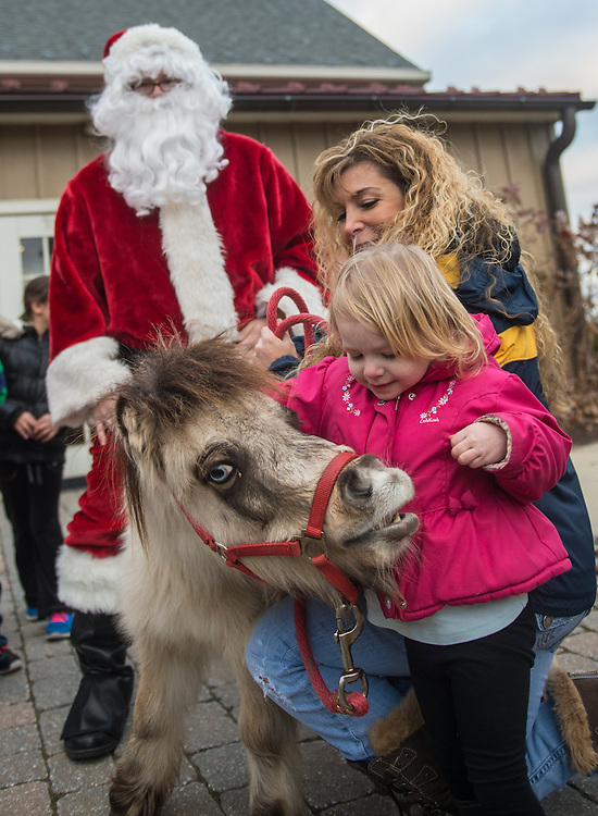 Sussanne Brennen, of Newtown, Kira Sottile, 4, and the dwarf horse Pistachio, visit with Santa during Sunday for Pets at the Bristol County Visitor Center in Bensalem, Pa, Sunday, December 14, 2014.  Photo by Bryan Woolston / @woolstonphoto.