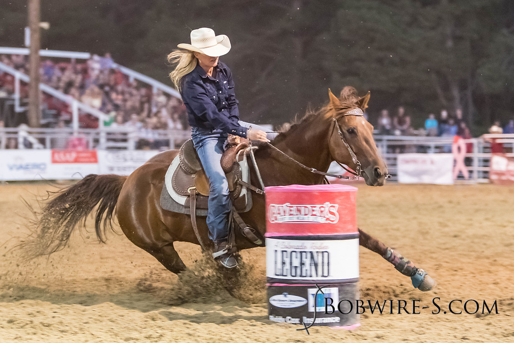Carrie Sutton makes her run in the barrel racing during the second performance of the Elizabeth Stampede on Saturday, June 2, 2018.