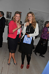 Left to right, REBECCA WAKEFIELD and CHARLOTTE BANKS at a fundraising party hosted by the Kensington and Chelsea Foundation at The Saatchi Gallery, Kings Road, London on 27th September 2011.