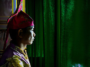 "12 JANUARY 2018 - BANGKOK, THAILAND:      A Chinese opera performer waits in the wings before going onstage during a performance at the Chaomae Thapthim Shrine in the Dusit district of Bangkok. Many Chinese shrines and temples host Chinese operas during the Lunar New Year. Lunar New Year is 16 February this year and opera troupes are starting their holiday engagements at local Chinese temples and shrines. The new year will be the ""Year of the Dog."" Chinese New Year, also called Lunar New Year or Tet, is widely celebrated in Chinese communities around the world. Thailand has a large Chinese community and Lunar New Year is an important holiday.    PHOTO BY JACK KURTZ"