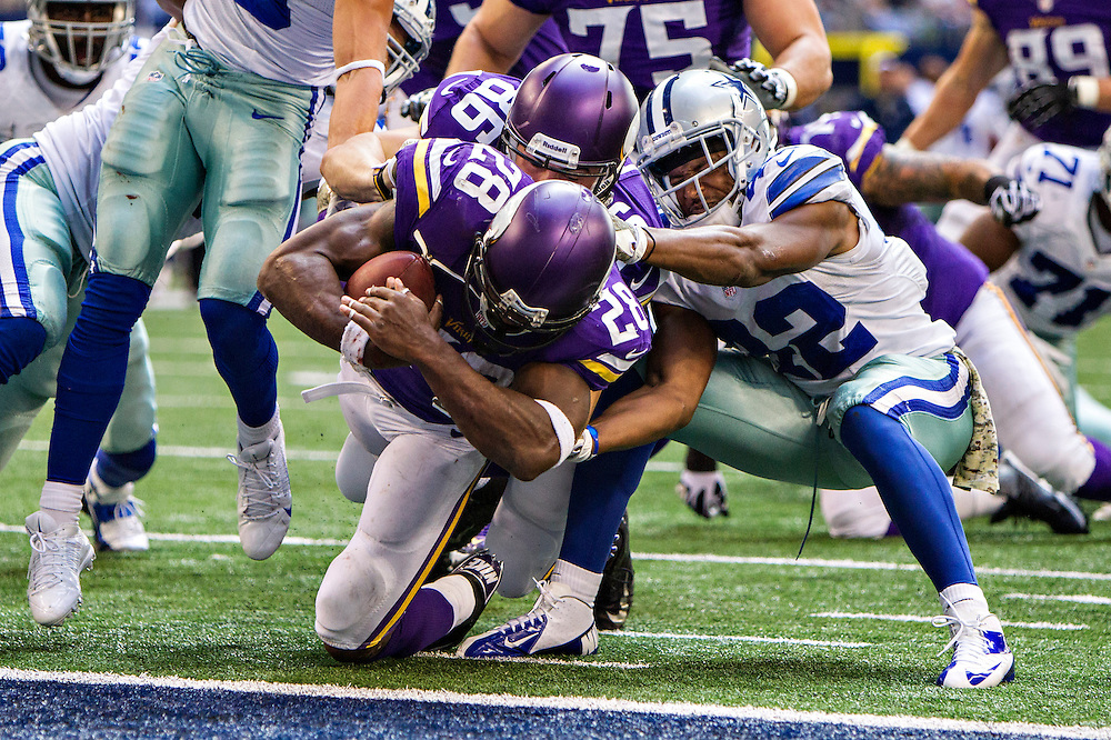 ARLINGTON, TX - NOVEMBER 3:  Adrian Peterson #28 of the Minnesota Vikings scores a touchdown against the Dallas Cowboys at  AT&T Stadium on November 3, 2013 in Arlington, Texas.  The Cowboys defeated the Vikings 27-23.  (Photo by Wesley Hitt/Getty Images) *** Local Caption *** Adrian Peterson