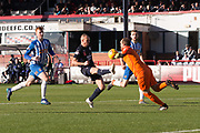 6th October 2018, Dens Park, Dundee, Scotland; Ladbrokes Premiership football, Dundee versus Kilmarnock; Jamie MacDonald of Kilmarnock saves from Kenny Miller of Dundee