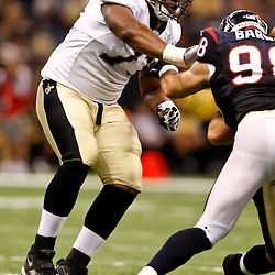 August 21, 2010; New Orleans, LA, USA; New Orleans Saints offensive tackle Charles Brown (71) blocks against Houston Texans defensive end Connor Barwin (98) during the second quarter of a preseason game at the Louisiana Superdome. Mandatory Credit: Derick E. Hingle