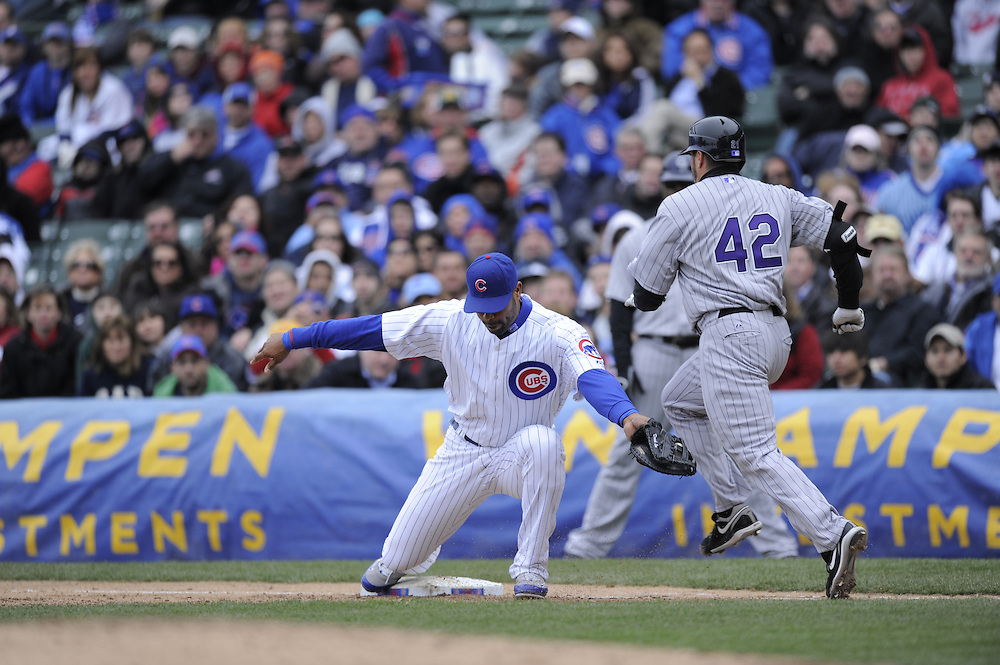 CHICAGO - APRIL 15:  Derrek Lee #25 of the Chicago Cubs makes a nice pick on a throw in the dirt against the Colorado Rockies on April 15, 2009 at Wrigley Field in Chicago, Illinois.  All players wore number 42 on this day only in honor of Jackie Robinson.  The Rockies defeated the Cubs 5-2.  (Photo by Ron Vesely)