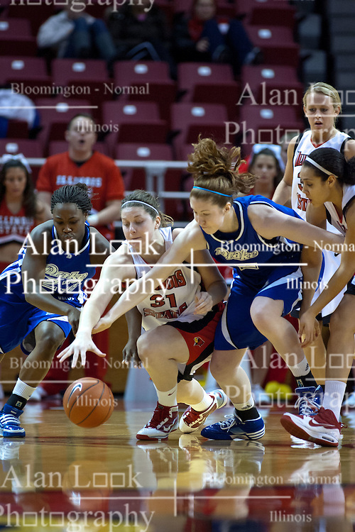 31 December 2009: Kayla Person, Nicolle Lewis and Rachel Hackbarth lunge for a loose ball. The Bulldogs of Drake fall to the Redbirds of Illinois State University by a score of 77-58in a Missouri Valley Conference game on Doug Collins Court in Redbird Arena in Normal Illinois.