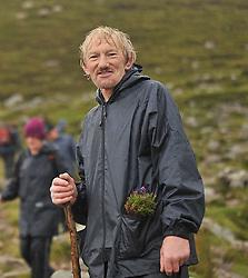 John Duffy from Kilmovee Co. Mayo a regular pilgrim since 1967 on his way up Croagh Patrick on reek sunday.<br /> Pic Conor McKeown