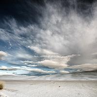 American desert scene with white clouds over remote location