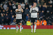 Fulham defender Joe Bryan (23) and Fulham defender Alfie Mawson (26) applaud the home fans after the Premier League match between Fulham and Leicester City at Craven Cottage, London, England on 5 December 2018.