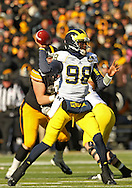 November 23 2013: Michigan Wolverines quarterback Devin Gardner (98) drops back to pass during the first quarter of the NCAA football game between the Michigan Wolverines and the Iowa Hawkeyes at Kinnick Stadium in Iowa City, Iowa on November 23, 2013. Iowa defeated Michigan 24-21.
