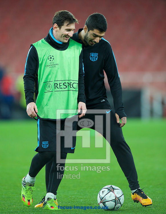 Lionel Messi (left) and Luis Suarez during the Barcelona training session at the Emirates Stadium, prior to their Champions League match against Arsenal tomorrow. London, England.<br /> Picture by Alan Stanford/Focus Images Ltd +44 7915 056117<br /> 22/02/2016