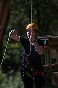 Ally Hearne helps students and parents climb the zipline tower at The Ridges on Parents Weekend. Photo by Hannah Ruhoff