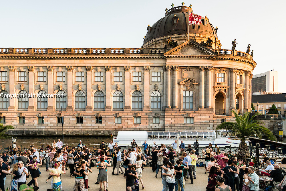 Weekend outdoor dancing in Monbijoupark beside River Spree and Bode Museum  in Mitte Berlin Germany