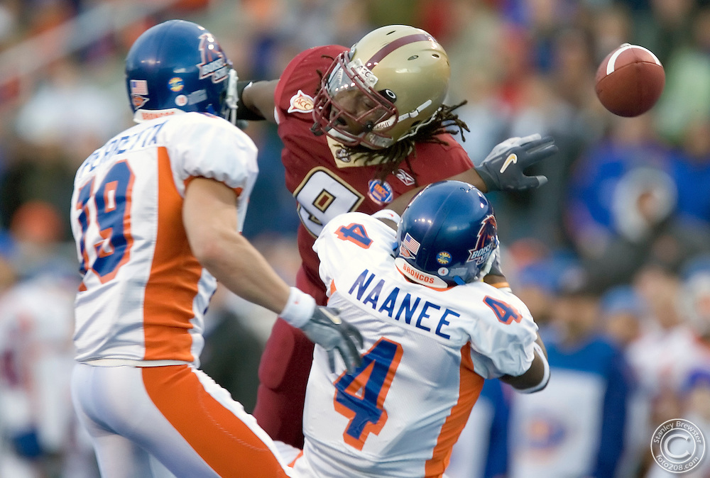 12-28-05-Boise ID. Boise State vs. Boston College in the 2005 MPC Computers Bowl in Bronco Stadium. Boston College free safety, Larry Anam (9) breaks up a pass intended for Boise State wide reciever Legedu Naanee. The Eagles beat the Broncos 27-21.