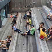 NEW YORK CITY - SEPTEMBER 03: People at High Line Park in NYC on September 03th, 2013. The High Line is a public park built on an historic freight rail line elevated above the streets on Manhattan West Side.