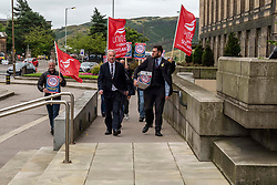 Pictured: Paul Sweeney, Labour and Co-operative MP for Glasgow North East,  and MSP James Kelly led workers to the front door of St Andrews House<br />