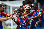 celebrate after scoring goal, Jeffrey Schlupp (15) of Crystal Palace, James McArthur (18) of Crystal Palace, Patrick van Aanholt (3) of Crystal Palace, Christian Benteke (17) of Crystal Palace with he's team mates  during the Premier League match between Fulham and Crystal Palace at Craven Cottage, London, England on 11 August 2018.