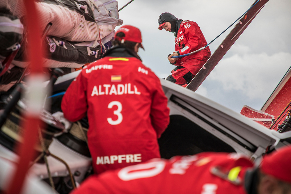 Leg 6 to Auckland, day 02 on board MAPFRE, Sophie Ciszek getting ready a sail for a pilling. 08 February, 2018.