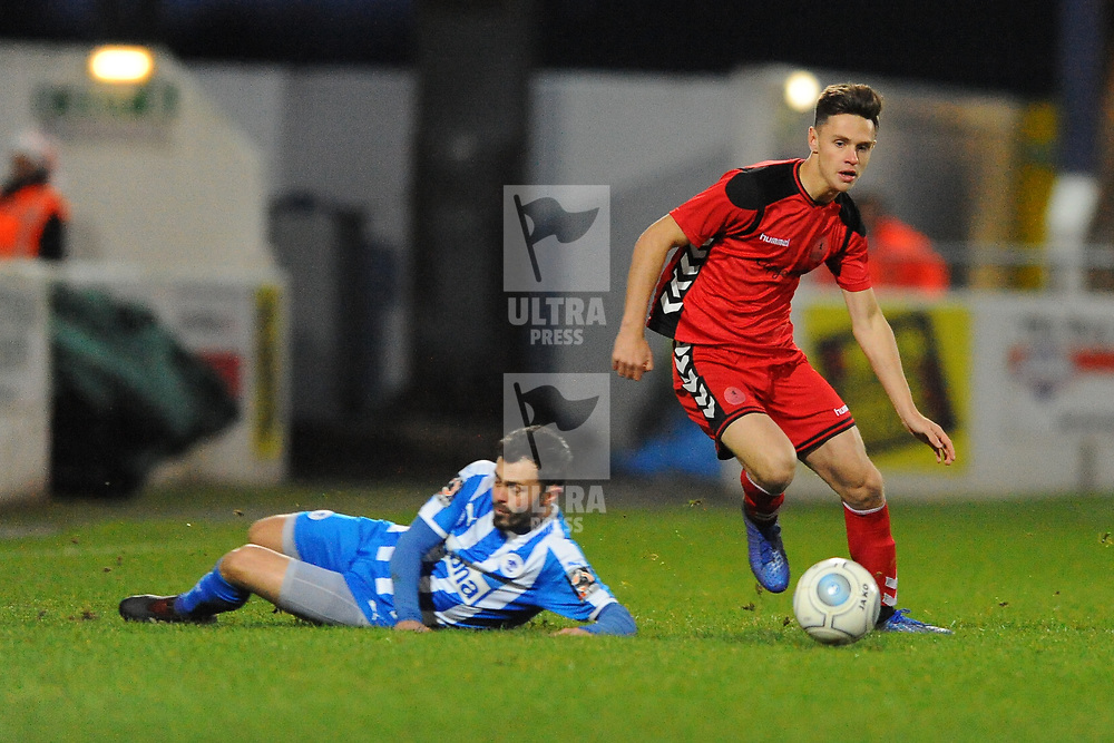 TELFORD COPYRIGHT MIKE SHERIDAN 22/12/2018 - Ryan Barnett of AFC Telford avoids the sliding tackle of Craig Mahon of Chester during the Vanarama Conference North fixture between Chester FC and AFC Telford United at the Swansway Deva Stadium, Chester.