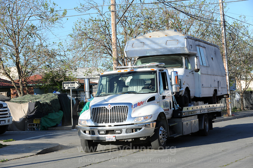 The home housing Diana Soto, Angel Menchaca, and their two small dogs is towed away by the city of Salinas in a sweep of homeless encampments on Thursday, March 24th in the Market Way area of Chinatown.