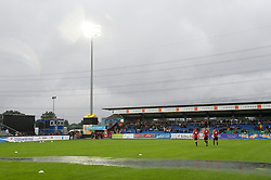 ALTACH, AUSTRIA - Saturday, July 17, 2010: Referee Ouschan Dominik and his assistants inspect the waterlogged pitch before Liverpool's first preseason match of the 2010/2011 season, against Al-Hilal Al Saudi FC, at the Cashpoint Arena. (Pic by David Rawcliffe/Propaganda)