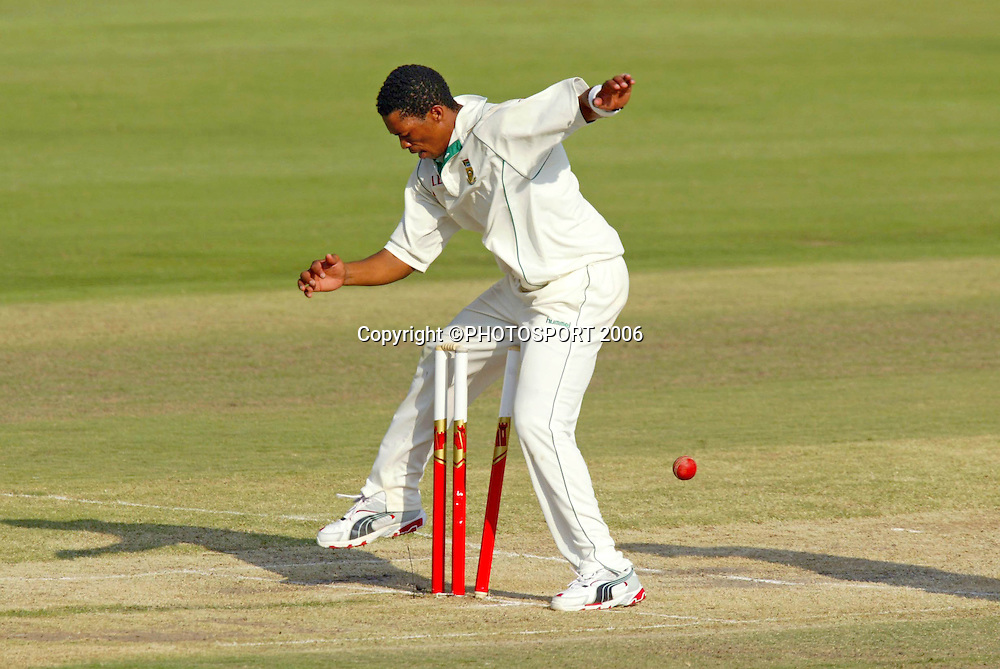 South African bowler Makhaya Ntini jumps as the ball hits the stumps during day two of the first cricket test between South Africa and New Zealand at SuperSport Park, Centurion, South Africa on Sunday 16 April, 2006. Photo: Africa Visuals/PHOTOSPORT**NZ USE ONLY**<br /> <br /> 160406 2