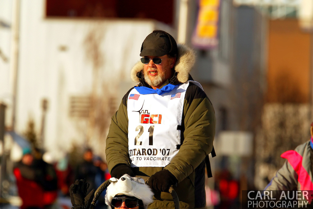 3/3/2007:  Anchorage Alaska -  Veteran Eric Rogers of Eagle River, AK comes down 4th Avenue during the Ceremonial start of the 35th Iditarod Sled Dog Race