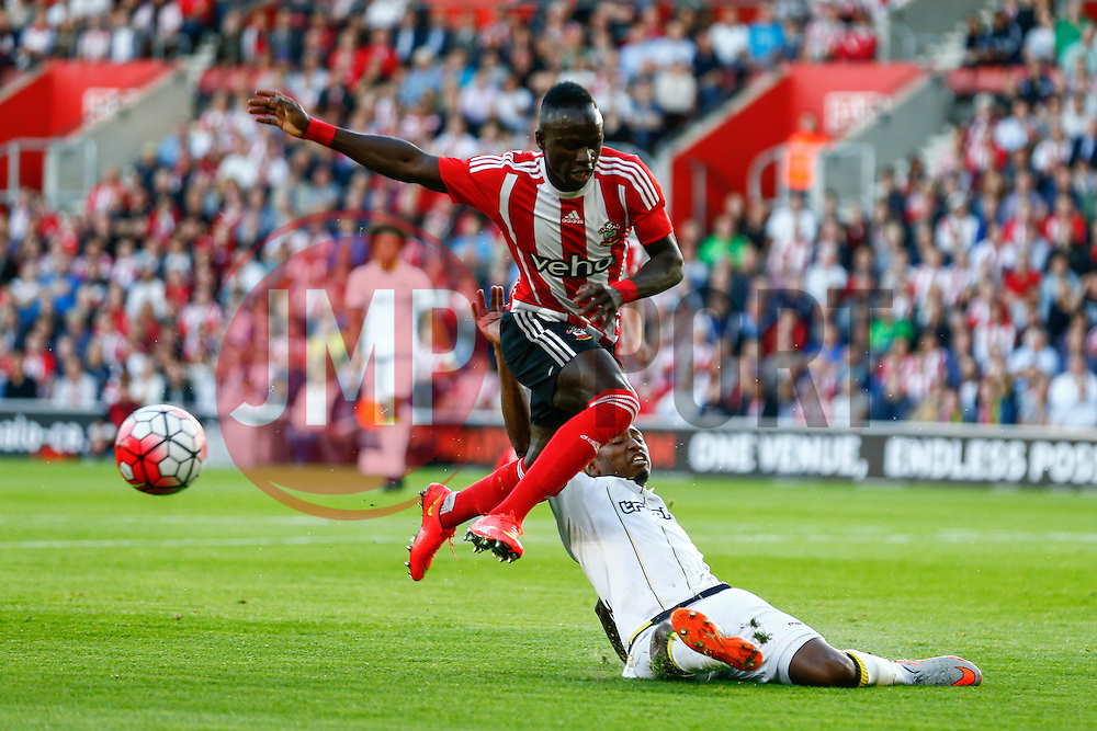 Kelvin Leerdam of Vitesse Arnhem tackles Sadio Mane of Southampton - Mandatory by-line: Jason Brown/JMP - Mobile 07966386802 - 31/07/2015 - SPORT - FOOTBALL - Southampton, St Mary's Stadium - Southampton v Vitesse Arnhem - Europa League