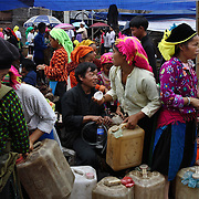 Scenes at the early morning market in Tam Son, Ha Giang, Vietnam's northernmost province, 23 June, 2007. As cities like Hanoi and Ho Chi Minh roar with Vietnam's economic boom, Ha Giang remains a quiet, serene and beautiful mountain backwater along the Chinese border.