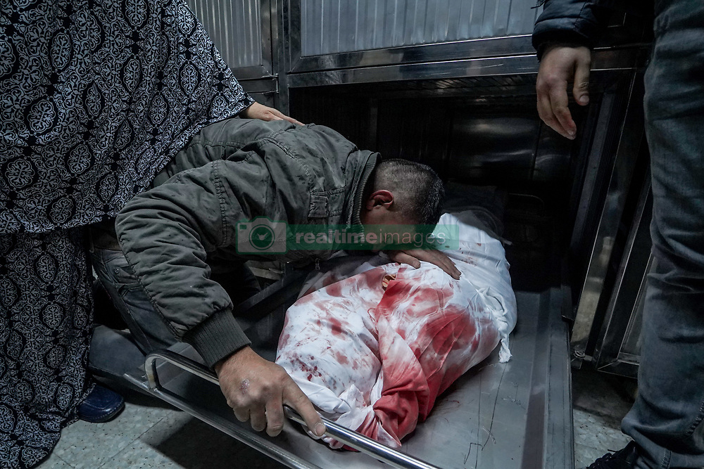 March 30, 2019 - Gaza, -------, Palestine - (EDITORS NOTE: Image depicts death).Adham Emara's body seen at the hospital mortuary..The family of Adham Emara, 17 who was killed during clashes with Israeli forces near the border with Israel seen at the hospital morgue in Beit Lahia to confirm the identity of the body. (Credit Image: © Mohamed Zarandah/SOPA Images via ZUMA Wire)