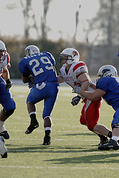 25 November 2006: Vincent Webb tries to escape the grasp of Niall Campbell. &#xD;The Redbirds romped the Panthers by a score of 24-13.&#xD;This game was a 1st round NCAA Division 1 Playoff held at O'Brien Stadium on the campus of Eastern Illinois University in Charleston Illinois.<br />