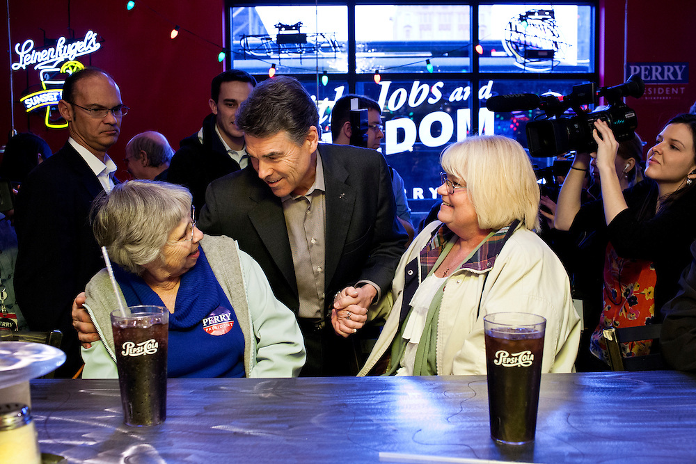 Republican presidential candidate Rick Perry greets patrons after a campaign event at Doughy Joey's Pizza on Friday, December 30, 2011 in Waterloo, IA.