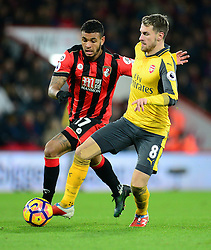 Aaron Ramsey of Arsenal battles for the ball with Joshua King of Bournemouth - Mandatory by-line: Alex James/JMP - 03/01/2017 - FOOTBALL - Vitality Stadium - Bournemouth, England - Bournemouth v Arsenal - Premier League