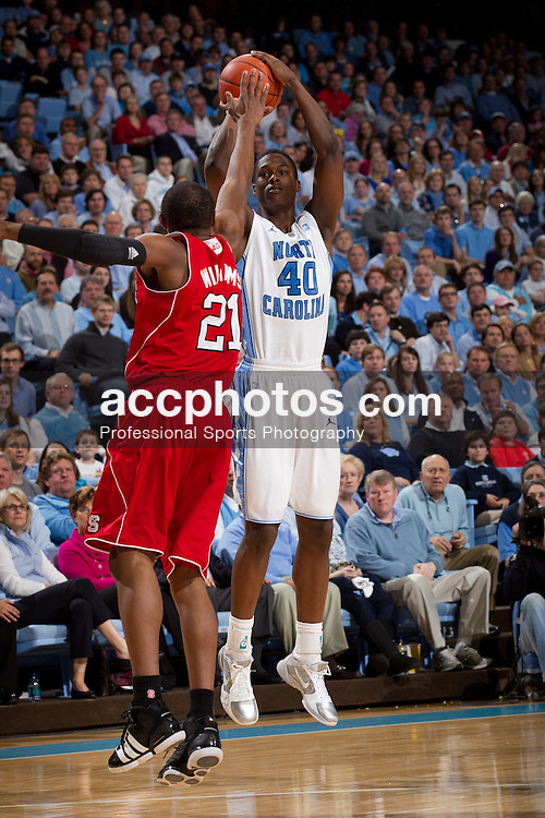 CHAPEL HILL, NC - JANUARY 29: Harrison Barnes #40 of the North Carolina Tar Heels shoots over the pressure from C.J. Williams #21 of the North Carolina State Wolfpack on January 29, 2011 at the Dean E. Smith Center in Chapel Hill, North Carolina. North Carolina won 84-64. (Photo by Peyton Williams/UNC/Getty Images) *** Local Caption *** Harrison Barnes;C.J. Williams