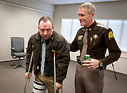 Major Mike Radich, right, pats Trooper B.J. Shelby on the back after a press conference at the Orem UHP Field Office, Monday, Dec. 31, 2012. Shelby was struck and injured by another motorist while assisting at a crash scene on Christmas Eve.