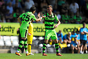 Mohamed Chemlal (25) of Forset Green Rovers is congratulated by Elliott Frear (11) of Forset Green Rovers on scoring the second goal to make the score 2-0 during the Vanarama National League match between Forest Green Rovers and Southport at the New Lawn, Forest Green, United Kingdom on 29 August 2016. Photo by Graham Hunt.