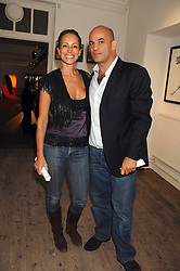 GUY & ANDREA DELLAL at a party to celebrate the opening of a new art gallery, 20 Hoxton Square, Hoxton Square, London on 27th April 2007.<br />