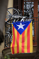 The red and yellow stripes, a white star on a blue background mark the Catalonion flag which is on display on many household in Barcelona, Spain.