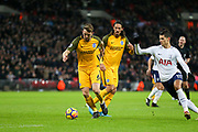 Brighton and Hove Albion midfielder Dale Stephens (6) battles with Erik Lamela of Tottenham Hotspur (11)  during the Premier League match between Tottenham Hotspur and Brighton and Hove Albion at Wembley Stadium, London, England on 13 December 2017. Photo by Phil Duncan.