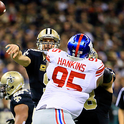 Nov 1, 2015; New Orleans, LA, USA; New Orleans Saints quarterback Drew Brees (9) throws a touchdown to wide receiver Brandin Cooks (not pictured) during the first quarter of a game against the New York Giants at the Mercedes-Benz Superdome. Mandatory Credit: Derick E. Hingle-USA TODAY Sports
