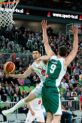 Saso Ozbolt of Union Olimpija vs Smiljan Pavic of Krka during second semi-final match of Basketball NLB League at Final four tournament between KK Union Olimpija and Krka (SLO), on April 19, 2011 at SRC Stozice, Ljubljana, Slovenia. (Photo By Matic Klansek Velej / Sportida.com)