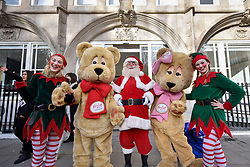 © Licensed to London News Pictures. 19/11/2017. London, UK.  Santa, elves and teddy bears join popular toy characters preparing to take part in Hamleys' annual Toy Parade in Regent Street along with marching bands and toy vehicles.  Photo credit: Stephen Chung/LNP
