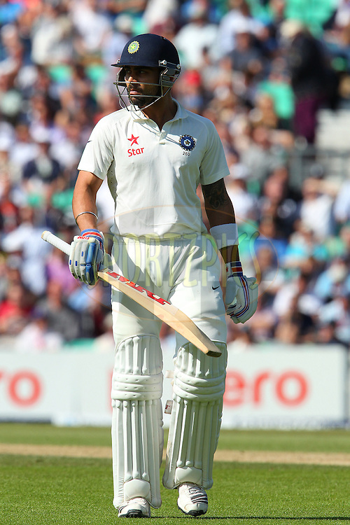 Virat Kohli of India departs during day three of the fifth Investec Test Match between England and India held at The Kia Oval cricket ground in London, England on the 17th August 2014<br /> <br /> Photo by Ron Gaunt / SPORTZPICS/ BCCI