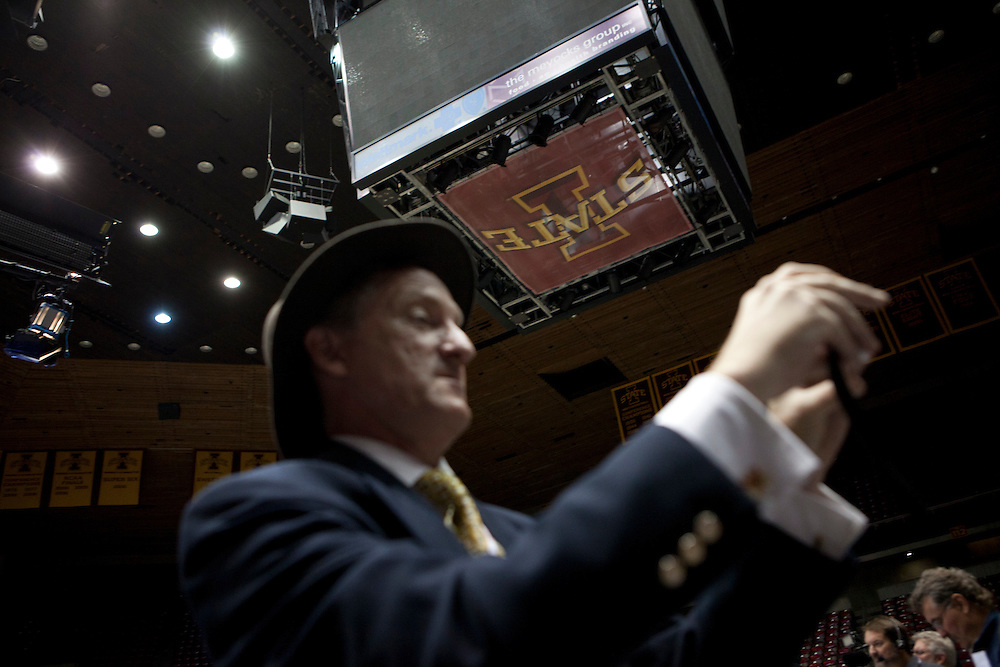 A reporter takes a photograph of Republican presidential hopeful Rick Santorum following the Republican presidential debate on Thursday, August 11, 2011 in Ames, IA.